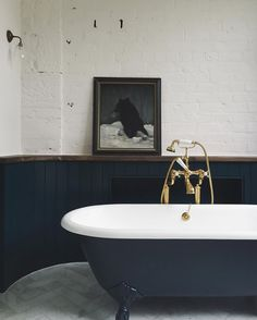 Dark colours can work well in the bathroom. Design and bathroom inspiration. Soakology.co.uk