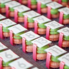 Macarons that match your color scheme will help guests find their seats in sweet, sugary style.