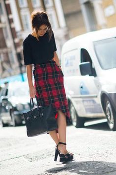 Holiday outfit ideas - Miroslava Duma in a plaid skirt, black top and chunky heels