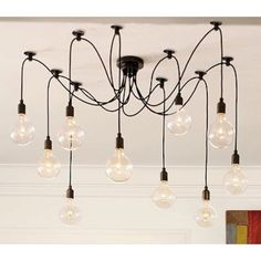 Edison Bare Ball Chandelier by Pottery Barn. We could do something like this on our own with colored bulb strings. Chandelier Bulle, Edison Bulb Chandelier, Bubble Chandelier, Edison Lighting, Diy Chandelier, Industrial Lighting, Kitchen Lighting, Home Lighting, Pendant Lamp