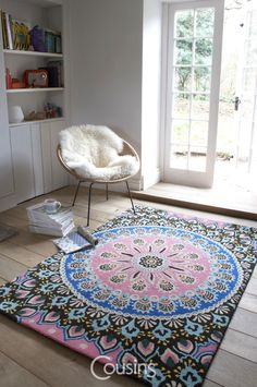 Nomadic rug is inspired by the feathers of a peacock. A vibrant palette of pinks, blues, greens and black sit together to create this jaw-dropping, must-have rug. The rug is available in square and circular version.