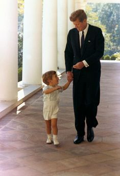 JFK & JFK Jr at White House, West Wing Colonnade. (October 10, 1963) Iconic America! What a charismatic man!