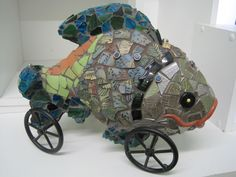 Mosaic fish on wheels  with Paverpol grout   -  http://www.omma.co/picture/mosaic%20fish.jpg?pictureId=9662096