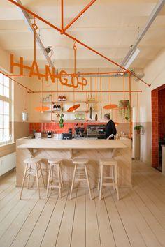Dutch design studio Overtreders W gives café Hangop a pop of orange to realize a contemporary hospitality concept on a low budget. Bar Design, Counter Design, Coffee Shop Design, Design Studio, Restaurant Design, Restaurant Bar, Orange Restaurant, Orange Cafe, Cafe Counter