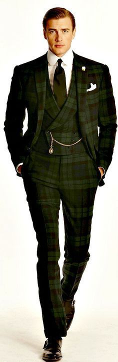 Really like the way this dark olive plaid three pc suit is pulled together with the pocket watch. Not everyone can pull this look off!