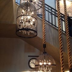 Chandelier inside bird cage with an awesome rope hanging it. Seen at restoration hardware. ohhhh, you could so do this on the cheap, with thrift store light, OR if ya wanna hang it outside use Christmas lights!!! too cute!!!