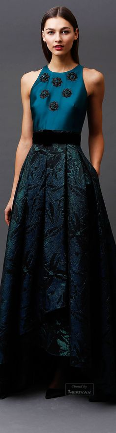 Badgley Mischka.Pre-Fall 2015.  The high-low skirt hem trend continues~a way of displaying beautiful shoes, a little leg and still appropriate for evening.