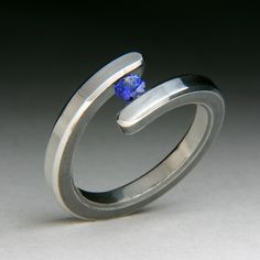 """""""Bi Pass Silver Tension Set Ring"""" Silver & Stone Ring Created by Robert Curnow Forging Metal, Gemstone Colors, Stone Rings, Metal Jewelry, Jewelry Stores, Jewelery, Sapphire, Silver Rings, Jewelry Making"""