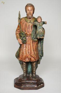 SÃO JOSÉ DE BOTAS - Imagem de madeira policromada com menino. Altura 85 cm.