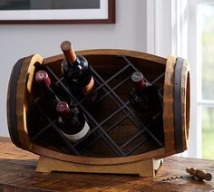 Besides the basics, your wedding registry should support your hobbies. And if you consider indulging in a nice bottle of vino to be one of your favorite activities (we won't judge), you'll probably want more than just stemless glasses. Channel your love for wine with a monthly wine club membership, or choose a unique wine rack like this one to start your budding cellar. | Pottery Barn Wedding Registry - Barrel Tabletop Wine Rack, Wedding Registry Ideas for the Foodie Couple