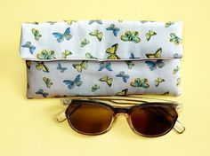 Items similar to Butterfly sunglasses pouch - unique glasses case - padded case - butterfly glasses - reading glasses holder - butterfly case lover gift on Etsy Butterfly Gifts, Butterfly Print, Cotton Twill Fabric, Etsy Uk, Wash Bags, Blue Design, Gift For Lover, Newcastle, Hand Drawn