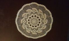 crotchet doily with pink flowers