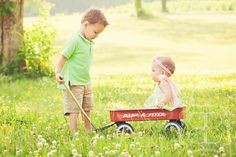 Baby girl and toddler Brother: this would be really cute of your two!! (maybe line a wagon with blankets and have her laying inside) @Jenni Juntunen Allen