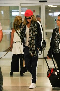Cara Delevingne Sports Pants - Cara Delevingne stayed comfy in Puma track pants and a matching jacket during a flight to JFK.