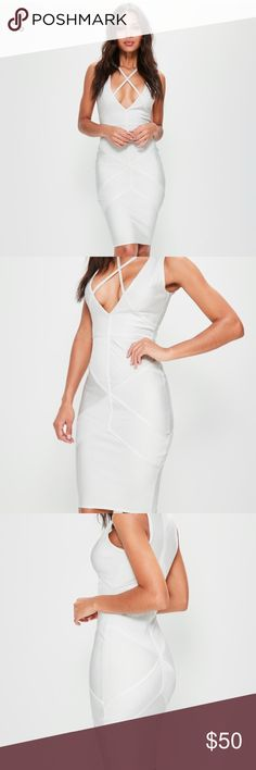 White Bandage Dress Size 0, NWT, perfect condition. Bought this but don't love the length on me. SOLD OUT in this size! Love their bandage dresses, always awesome quality. Missguided Dresses Midi