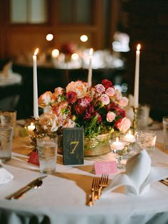 Low centerpieces encourage table talk among your guests. Intersperse a few tall candles for a delicate glow that still allows for easy conversation.