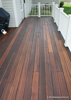 A mahogany deck finished in a medium brown oil. Mahogany decks can absorb a substantial amount of oil making them last much longer. Wood Deck Stain, Deck Stain Colors, Deck Colors, Deck Colour Ideas, Painted Wood Deck, Deck Refinishing, Deck Staining, Mahogany Decking, Deck Finishes