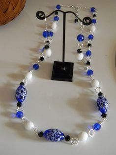 A spin on Spectator! This time in blue, black & white! So fresh, with blown glass beads hand-linked to create this necklace with cobalt, opaque white & twist-cut black Czech glass cystals! All done in sterling silver plate. Includes a pretty drop earring! $20 the set