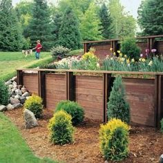 How to Build a Retaining Wall. Eliminate steep difficult to mow slopes stop erosion and create attractive planting beds with an easy to assemble wood retaining wall. Wooden Retaining Wall, Retaining Wall Steps, Retaining Wall Design, Building A Retaining Wall, Concrete Retaining Walls, Landscaping Retaining Walls, Patio Steps, Building A Fence, Backyard Landscaping