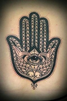 Hamsa tattoo (where the fish are is a wolf and a lion!)