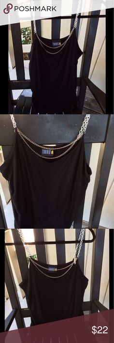 Vintage Torrid Biker Sexy Chain Black Tank Top Vintage Torrid Biker Rocker Sexy Chain Black Tank Top 2X So Sexy On..Soft Slinky..built in Support..bad to the bone ☠️ Good Used Condition from 2000 Torrid Tops Tank Tops