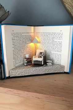 10 Bookshelf Dioramas That Are Literally Works of Art - - If you're a bookworm, chances are you have a bookshelf at home that houses some of your favorite reads. And while bookshelves being stocked with books is great. Miniature Rooms, Miniature Crafts, Diy And Crafts, Fun Crafts, Paper Crafts, Box Creative, Old Book Crafts, Book Sculpture, Paper Sculptures
