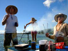 Grilling in Tahiti on a sandbar.