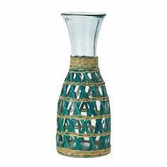 "Glass carafe with a woven seagrass sleeve. Crafted with eco-friendly recycled materials.    Product: CarafeConstruction Material: Recycled glass and seagrassColor: AquaFeatures: Eco-friendly 34 Ounce capacityDimensions: 10.6"" H x 4"" DiameterCleaning and Care: Hand wash"
