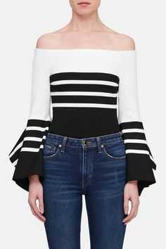 Rosetta Getty is focused on developing new connections between wearer and maker, process and presentation. Made in Italy of stretch jersey, this off-the-shoulder top makes a statement with bold block striping and flared, vented cuffs. A solid black panel is placed to flatter the waist.