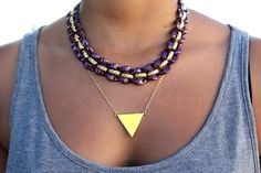 try layering necklaces! simple with bold!