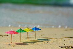 Fun colorful umbrellas on the beach | 500px