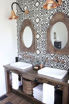 Rustic wood vanity with shallow vessel sinks, accent tile wall and copper lights