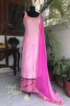 Elegance is the only beauty that never fades.  Baby pink pure silk  straight suit with hand embroidery on the neck and bootis all over the kurta teamed with a rani cotton silk palazzo with fish scale pauncha with sequin work. Tri colour pure chiffon dupatta completes the set.  Available exclusively at  Rimi Singh Studio A 999 Sushant Lok 1  Gurgaon  #9818310054 Punjabi Fashion, Ethnic Fashion, Indian Fashion, Pakistani Dresses, Indian Dresses, Indian Outfits, Salwar Designs, Blouse Designs, Indian Attire