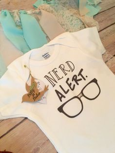 NERD ALERT!  Unisex baby boy (or girl) bodysuit OR t-shirt with adorable Hipster classic nerd glasses drawing and NERD ALERT. printed across the front. This funny baby graphic print Onesie® is sure to bring smiles and set your little smarty pants apart from the rest. Also makes a great baby shower gift for the geek, nerd, glasses wearer and more.   >>----> IMPORTANT INFO BELOW <----<<   This listing is for the Gerber brand onesie®/bodysuit or T-Shirt item shown ONLY. All other items shown in…