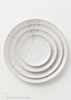 "A refined, geometric approach, inspired by the marble of Carrara. Lined in 24k gold. $14.00 | Charger Plate (13"") $7.00 