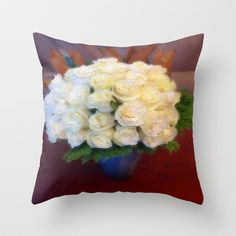 Gorgeous pillow featuring a digitally altered photo of white roses in a blue vase on a deep red hued table. #marsala #whiteroses #2015weddingcolor $35.00