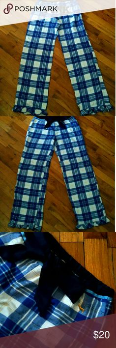 """PINK VS Pajama Pants Adorable cotton flannel pajama pants by PINK Victoria's Secret in excellent used condition. White, blue, and metallic gold striped flannel. """"PINK"""" displayed on the back in dark navy outlined in metallic gold. The top of the pants are hemmed with a silk material, along with a silk drawstring that can be tied for comfort and fit. The bottom of the pants are hemmed with ruffles to complete the look. These are a size XS but can fit a small, and medium but run a little snug…"""