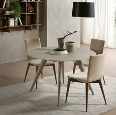 The Elegance dining table is a round extendable table with legs in solid ash that expands to create more dining space for guests.