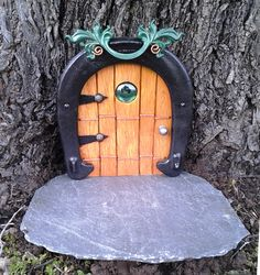 "Horseshoe fairy / troll / hobbit door made with a ""throwing"" horseshoe and slate bottom"