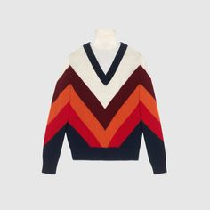 Gucci 2017. Chevron intarsia knitted top. The 70s chevron pattern is incorporated throughout Gucci's collections and continues to evolve season after season. The jeweled buttons decorate the cuffs and shoulders and add a whimsical touch to this knitted turtleneck top.