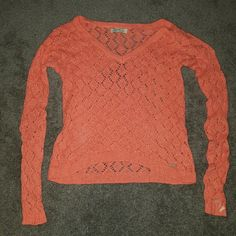 Coral Sweater Diamond print knit, pinkish orange coral color, high to low hem, loose fitting but tighter in sleeves, barely worn Gilly Hicks Sweaters V-Necks