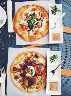 Food- Pizza. Dinner for two, pizza night, truffle oil, white serving platters, table setting, blue outdoor table, roasted peppers, cute lunch idea, individual pizza, day date, summer pizza