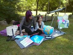 A Sonlight mom and her daughter read outside