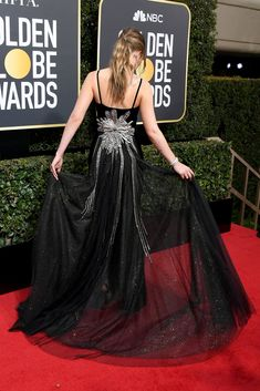Dakota Johnson's Golden Globes Dress Has the Most Unexpected Back Detail | Dakota Johnson's Gucci dress for the Golden Globes had an amazing starburst surprise in the back. See it from every angle here.