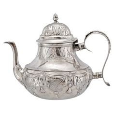 For a mere $4,000 Estate Betteridge Collection Antique Dutch Silver Tea Pot with Rustic Pattern
