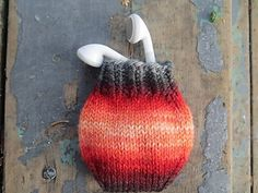 I made this little pouch to keep my earbuds safe and untangled in my purse, but it came out so well I wanted to share it for gift knitting! They're addictive to knit and I keep scheming about using them as wrapping for a pair of earrings or just a few small candies to pair with a gift card or as a topper for a larger present. I can't think of a cuter way to tuck a lost tooth under a child's pillow for the tooth fairy, either.