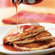 Buttermilk-Banana Pancakes with Pomegranate Syrup What beautiful combination of fruity flavors! Enjoy!