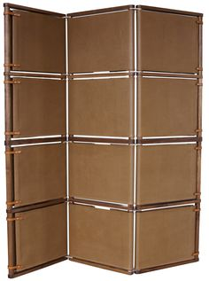 An elegant and handsome way to add height to any room. Can be ordered in 2 to 3 feet panel screens. The screen comes in various materials including canvas and leather, with English leather bridle strapping to add dash to this already striking screen. Aluminum hinges allow free movement in any direction.