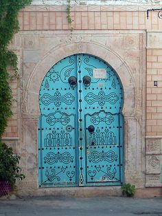 One of the highly decorated and colourful doors in the alleyways of the Medina (the Arabic old town) in Tunis, Tunisia, North Africa