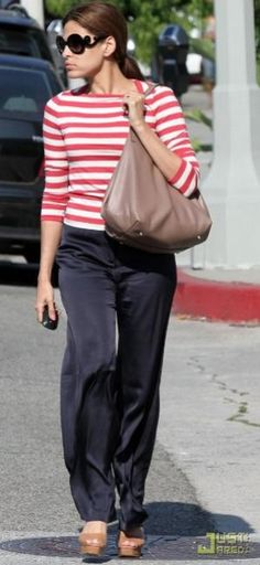 2cbaa36fc72 Eva Mendes wearing CH Carolina Herrera Matryoshka Bag Prada Baroque Round  Graphic Sunglasses Prada Spring 2011